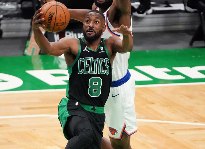 Celtics guard Kemba Walker drives to the basket against the Knicks during the second quarter Sunday at TD Garden.