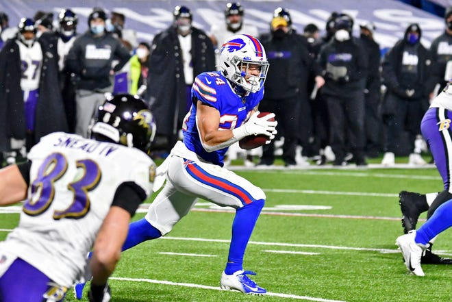 Bills cornerback Taron Johnson returns an interception 101 yards for a touchdowns in the second half against the Ravens in Buffalo.