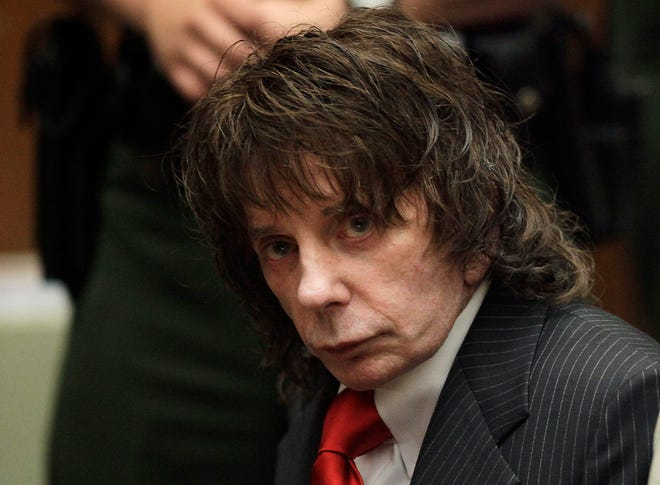 """In this May 29, 2009 photo, music producer Phil Spector sits in a courtroom for his sentencing in Los Angeles. Spector, the eccentric and revolutionary music producer who transformed rock music with his """"Wall of Sound"""" method and who was later convicted of murder, died Jan. 16, at age 81."""