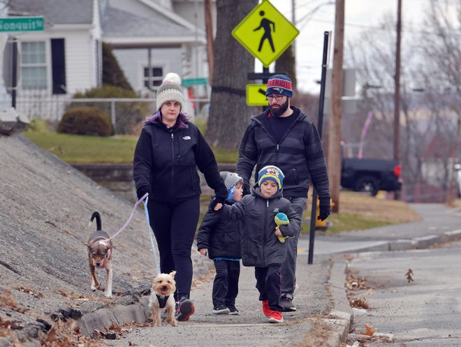 WORCESTER - The Daneshmand family takes in a breath of fresh air as they walk their dogs down Lake Ave. on  Sunday, January 17, 2021.