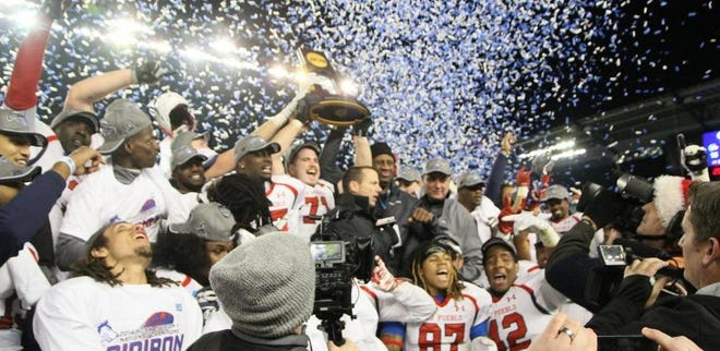 The 2014 CSU Pueblo football celebrates after winning the Division II national title.