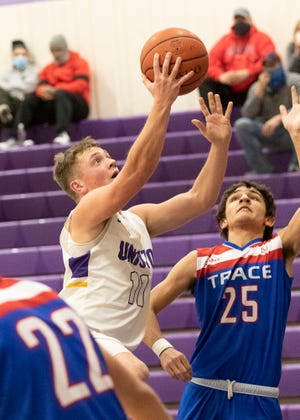 Unioto's Isaac Little takes it to the rim to try and score for Unioto against Zane Trace on Jan. 16, 2021. Little would score his 1000th point during the game and helped Unioto soar past Zane Trace with a score of 50-38.