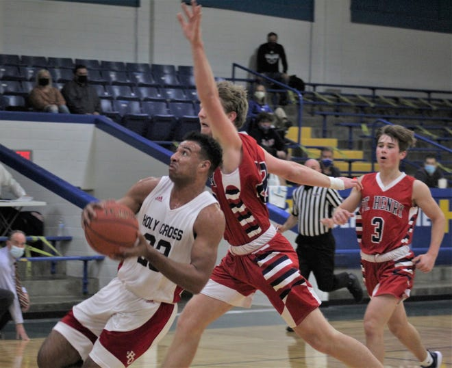 """Holy Cross senior Jeremiah Hicks tries to get up a shot as St. Henry defeated Holy Cross 58-54 in the 9th Region All """"A"""" championship game in boys basketball Jan. 16, 2021 at Newport Central Catholic HS, Newport, Ky."""