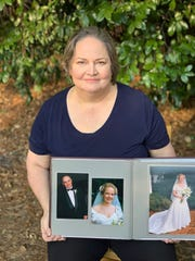 Elizabeth Kurylo holds an image of her dad, Mike, who died from COVID-19.