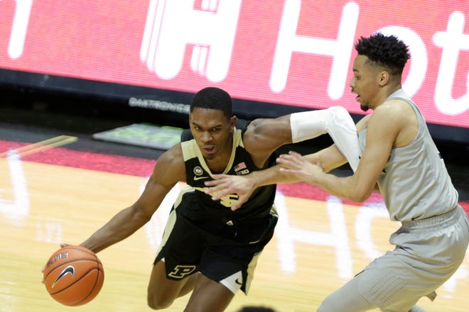 Purdue guard Brandon Newman (5) dribbles against Penn State guard Sam Sessoms (3) during the first half of an NCAA men's basketball game, Sunday, Jan. 17, 2021 at Mackey Arena in West Lafayette.
