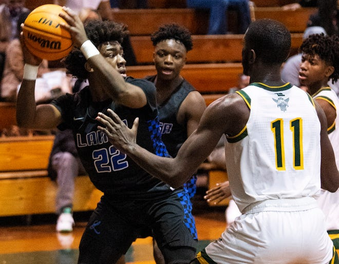 Lanier's Eddie Holcombe (22) against Jeff Davis on the JDHS campus in Montgomery, Ala., on Saturday January 16, 2021.