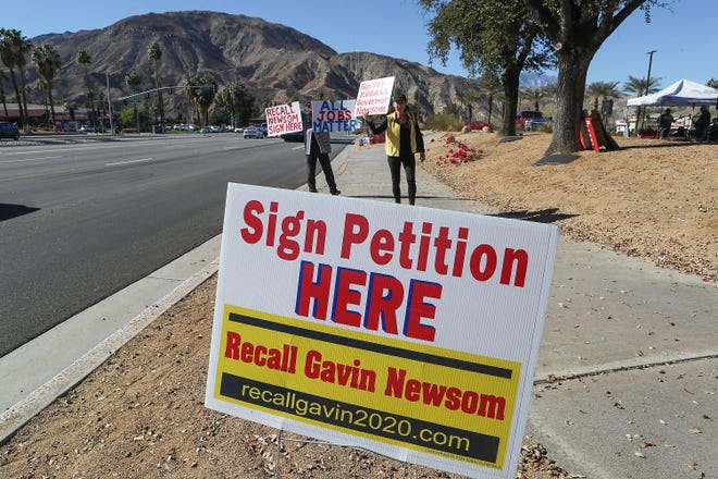 People participate in an effort to get enough signatures to recall Gov. Gavin Newsom during a rally at Westfield Palm Desert, January 17, 2021.