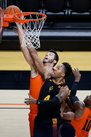 Oregon State Beavers center Roman Silva (back) and Arizona State Sun Devils forward Kimani Lawrence (4) battle for a rebound during the first half at Gill Coliseum.