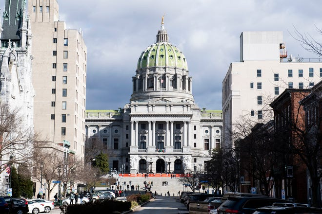 Cloudy afternoon skies can be seen behind the Pennsylvania State Capitol complex in Harrisburg on Sunday, January 17, 2021.