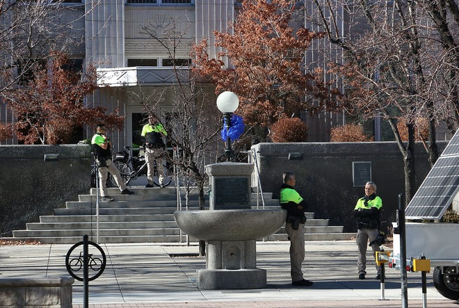 Carson Sheriff's officers stand in front of the Office of the Attorney General in Carson City on Jan. 17, 2021.