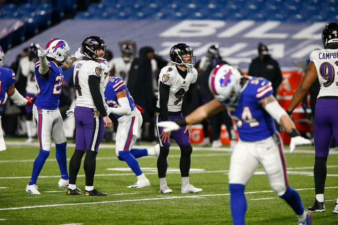 Baltimore Ravens kicker Justin Tucker (9) reacts after missing a field goal during the first half Saturday.