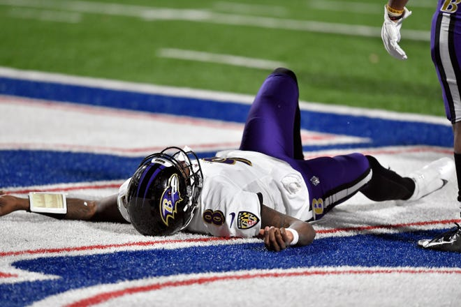 Baltimore Ravens quarterback Lamar Jackson (8) lies on the ground after being injured during the second half of an NFL divisional round football game against the Buffalo Bills Saturday, Jan. 16, 2021, in Orchard Park, N.Y. Jackson left the game after his injury. (AP Photo/Adrian Kraus)