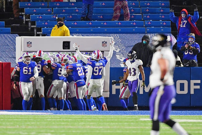 Bills cornerback Taron Johnson (24) celebrates with his teammates after  he intercepted the ball in the end zone and returned it 101 yards for a touchdown to extend Buffalo's lead 17-3.
