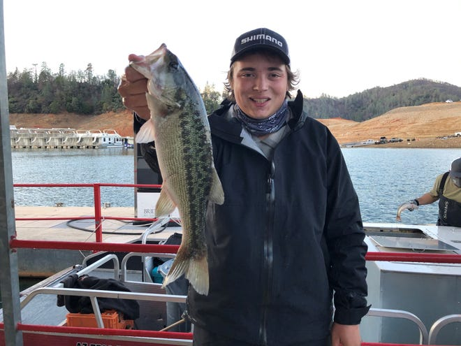 16-year-old Westley Grits of Folsom holds a spotted bass after competing at the Wild West Bass Pro-Am at Lake Shasta on Jan. 16, 2021.
