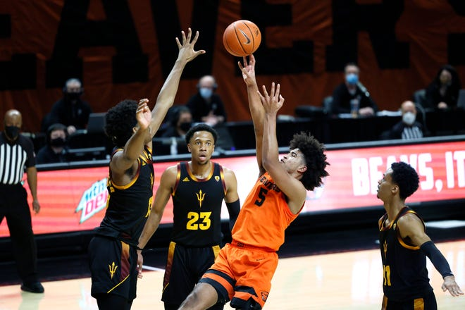 Jan 16, 2021; Corvallis, Oregon, USA; Oregon State Beavers guard Ethan Thompson (5) shoots the ball over Arizona State Sun Devils guard Josh Christopher (13) during the second half at Gill Coliseum. Mandatory Credit: Soobum Im-USA TODAY Sports
