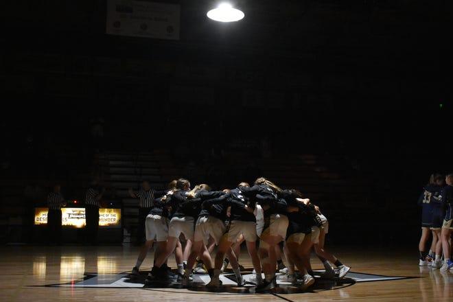 The Desert Hills' girl's basketball team huddles before taking on Snow Canyon.