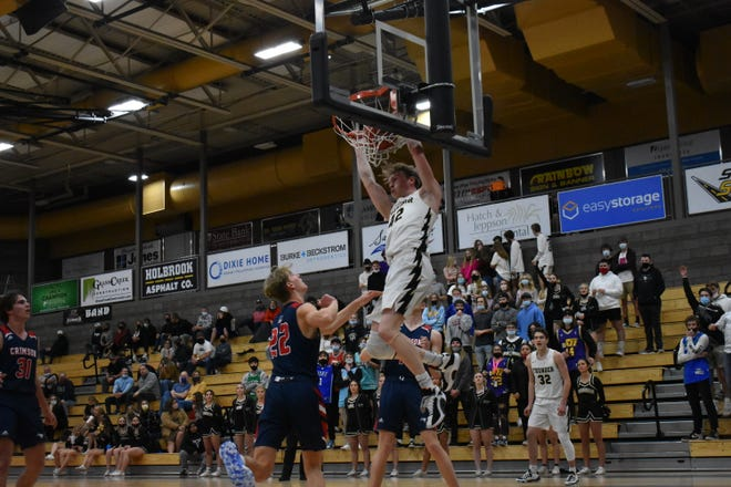 Desert Hills' Keegan Munson throws down a dunk against Crimson Cliffs.