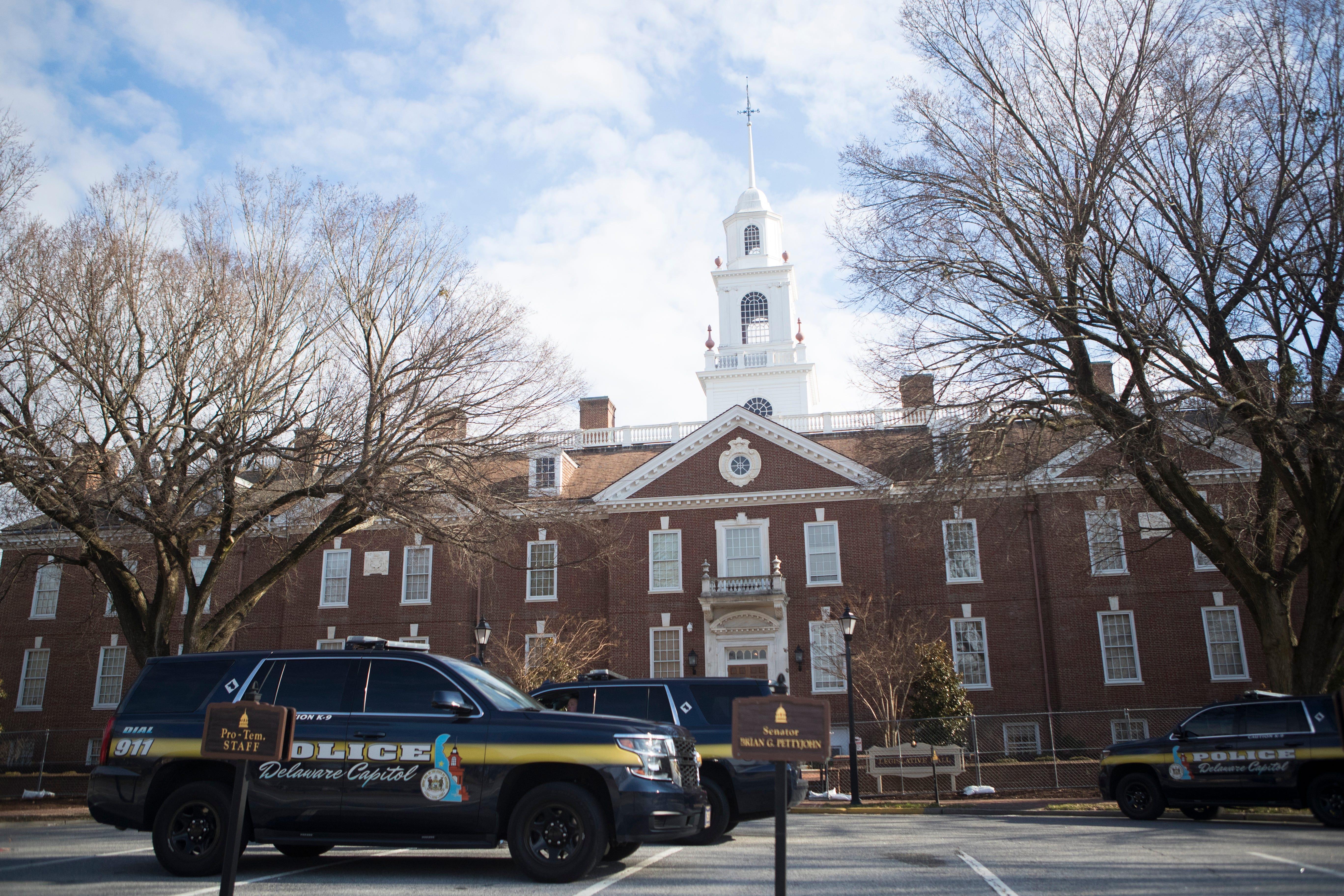 Capitol Police sit outside of Legislative Hall in Dover, Del., on Sunday, Jan. 17, 2021.