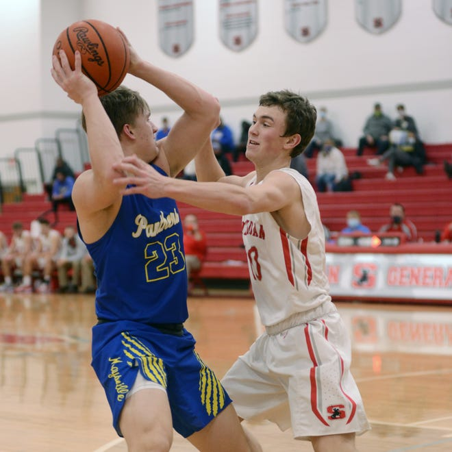 Maysville's Hayden Jarrett, left, is pressured by sophomore Reed Coconis during Sheridan's 61-40 win against visiting Maysville on Saturday night at Glen Hursey Gymnasium.