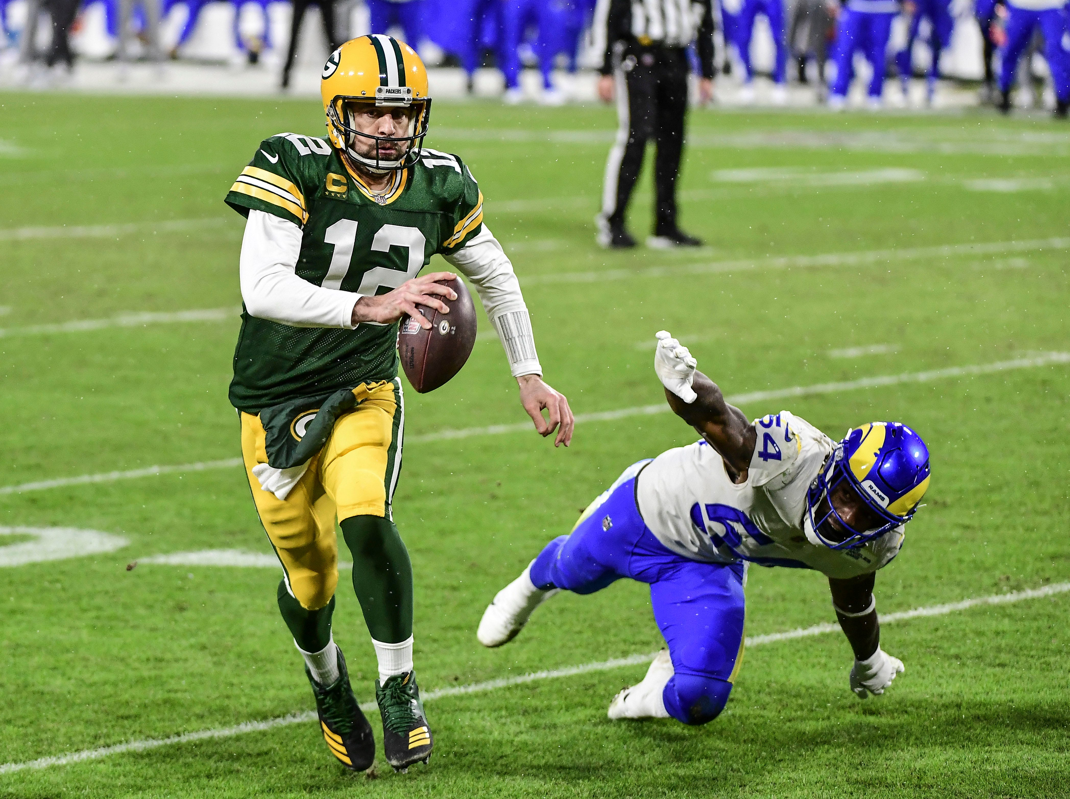 Green Bay Packers, Aaron Rodgers pull away from L.A. Rams, will host  NFC championship game