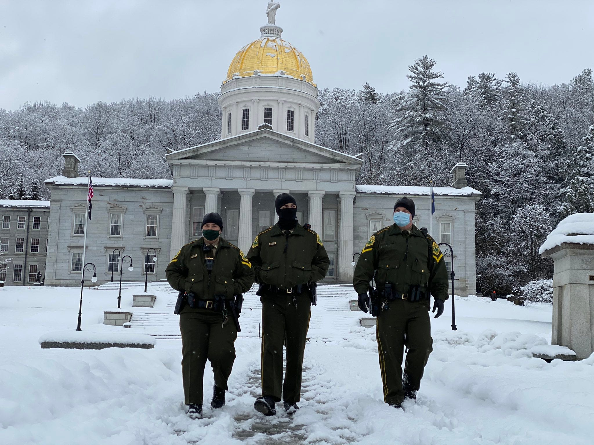 Multiple patrols of state troopers walk the Statehouse grounds in Montpelier, Vt., on Sunday, Jan. 17, 2021.