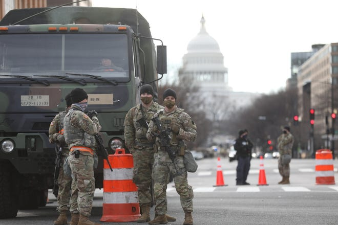 Members of the National Guard deployed in Washington, DC stand guard at the intersection of New Jersey Ave. NW and Massachusetts Ave. NW. near the U.S. Capitol on Jan 17, 2021.