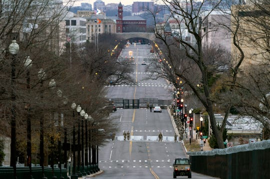 Independence Avenue is blocked to traffic all along the National Mall, as seen from by the U.S. Capitol, Saturday, Jan. 16, 2021, in Washington, as security is increased ahead of the inauguration of President-elect Joe Biden and Vice President-elect Kamala Harris.