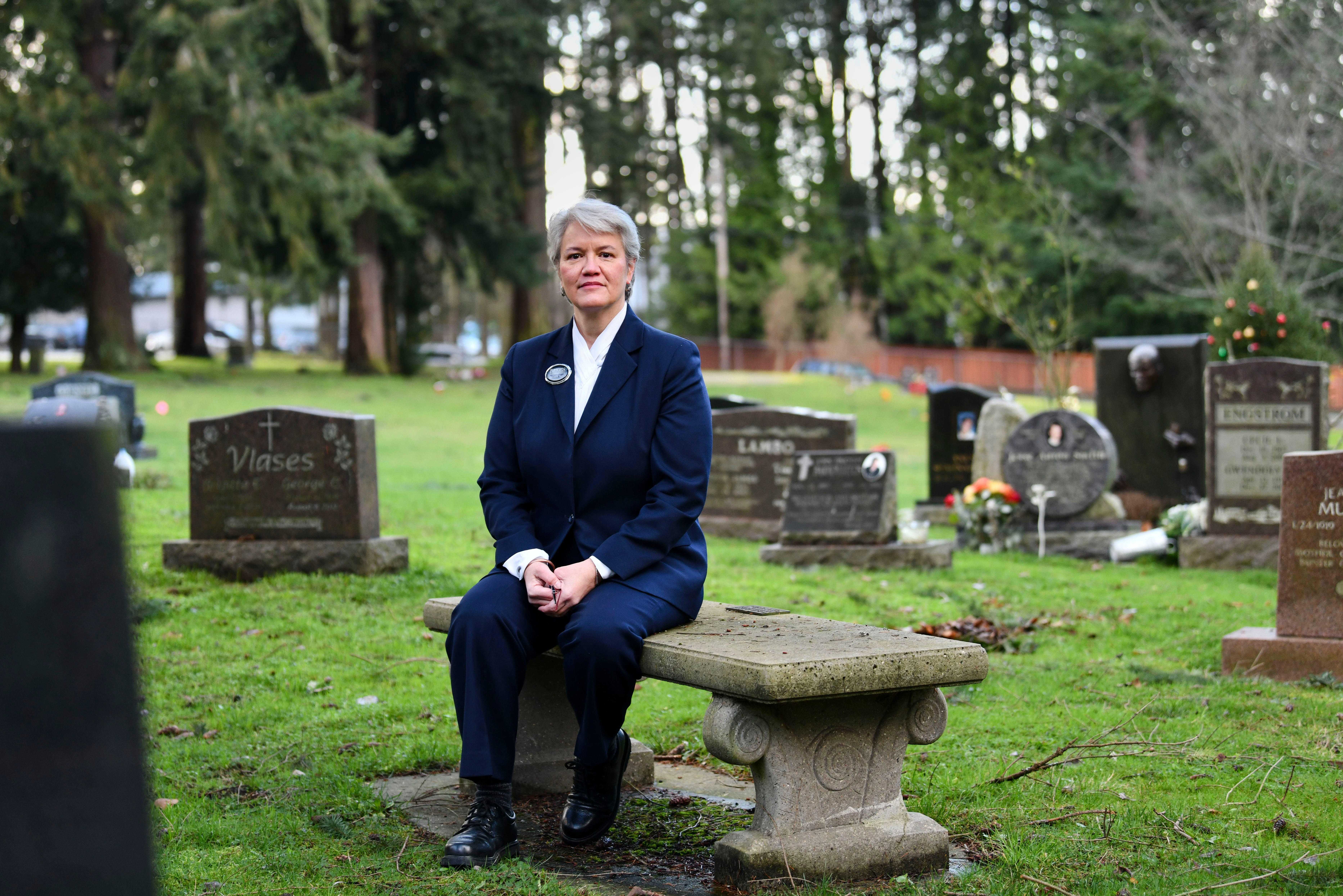 """Elizabeth Baty, 58, a funeral director at a family-run funeral home in King County, Wash., recalls gathering with a dozen staff members in the company chapel in late February 2020 to discuss the coronavirus pandemic. """"We had a what-if situation,"""" Baty said. What if the virus came to King County? What if we ran out of PPE? Days later, residents at the nearby LifeCare Center of Kirkland nursing home would begin to die of COVID-19."""