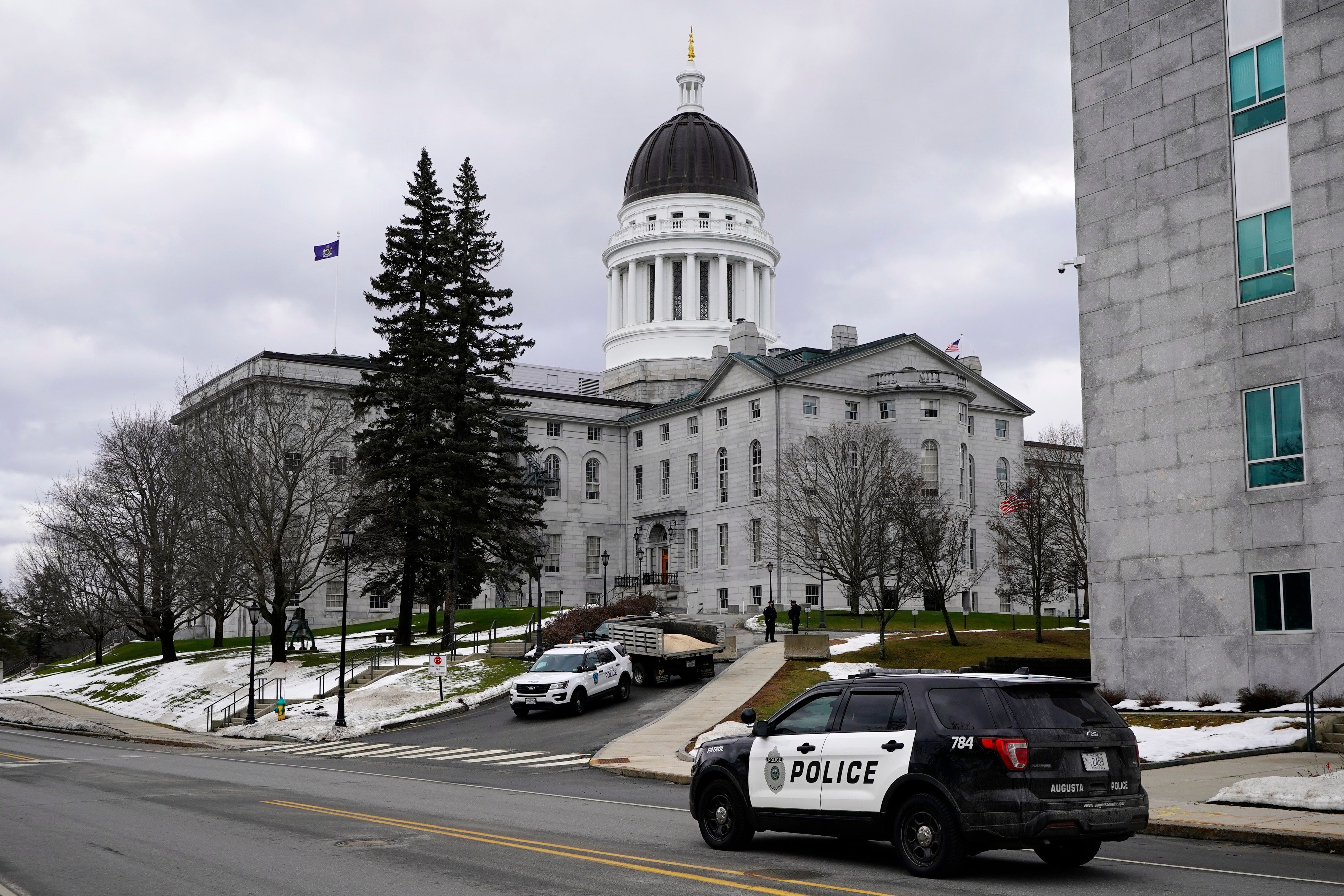 Capitol Police and Augusta Police patrol the Statehouse grounds, Sunday, Jan. 17, 2021, in Augusta, Maine. Law enforcement is taking precautions for possible demonstrations in the wake of the recent breach of the U.S. Capitol.