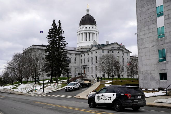 Capitol Police and Augusta Police patrol the State House grounds, Sunday, Jan. 17, 2021, in Augusta, Maine. Law enforcement took precautions for possible demonstrations in the wake of the recent breach of the U.S. Capitol.
