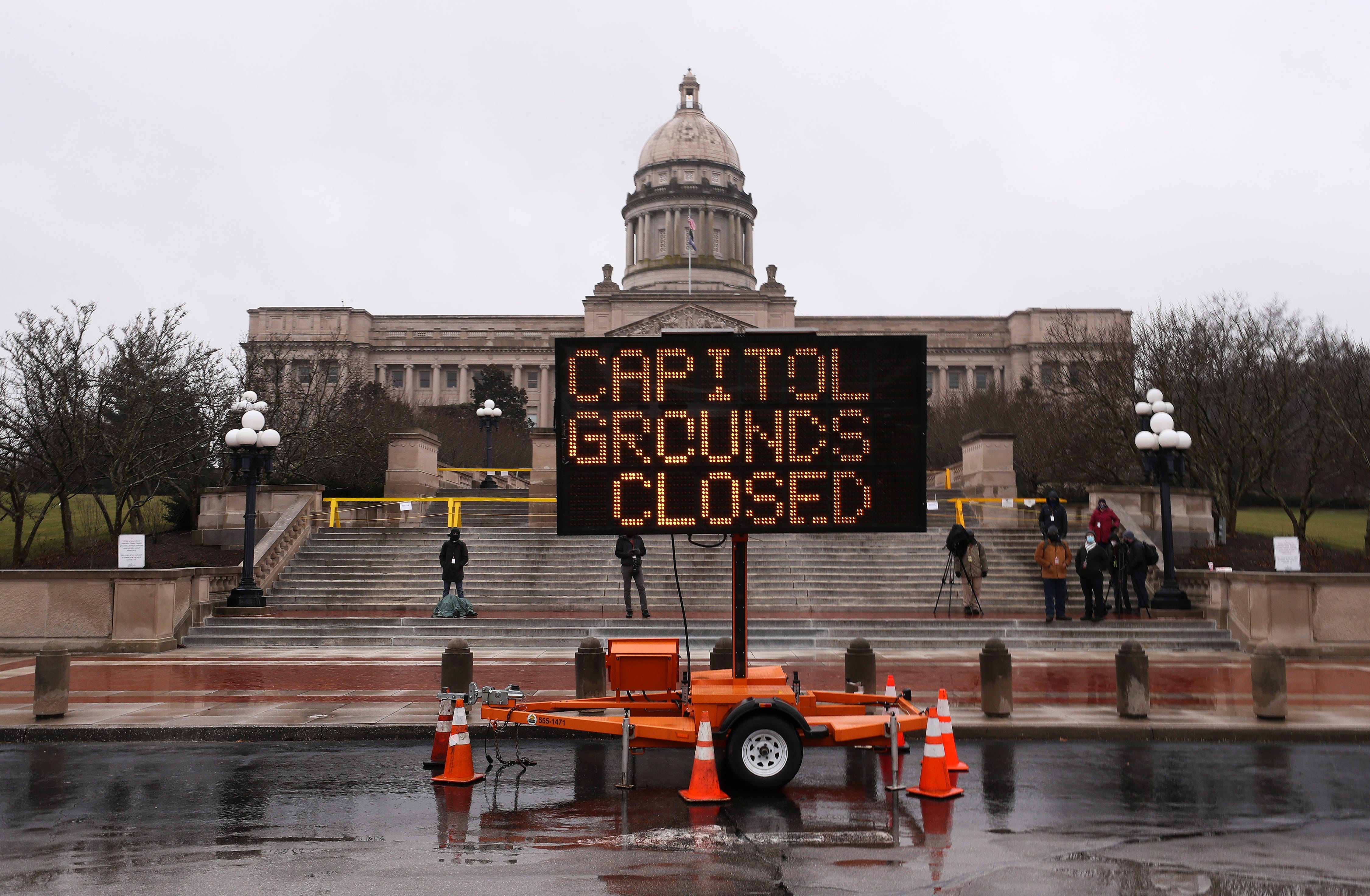 A sign notifying the public that the Kentucky State Capitol grounds are closed to the public is displayed outside the Capitol building in Frankfort, Ky., on Sunday, Jan. 17, 2021.
