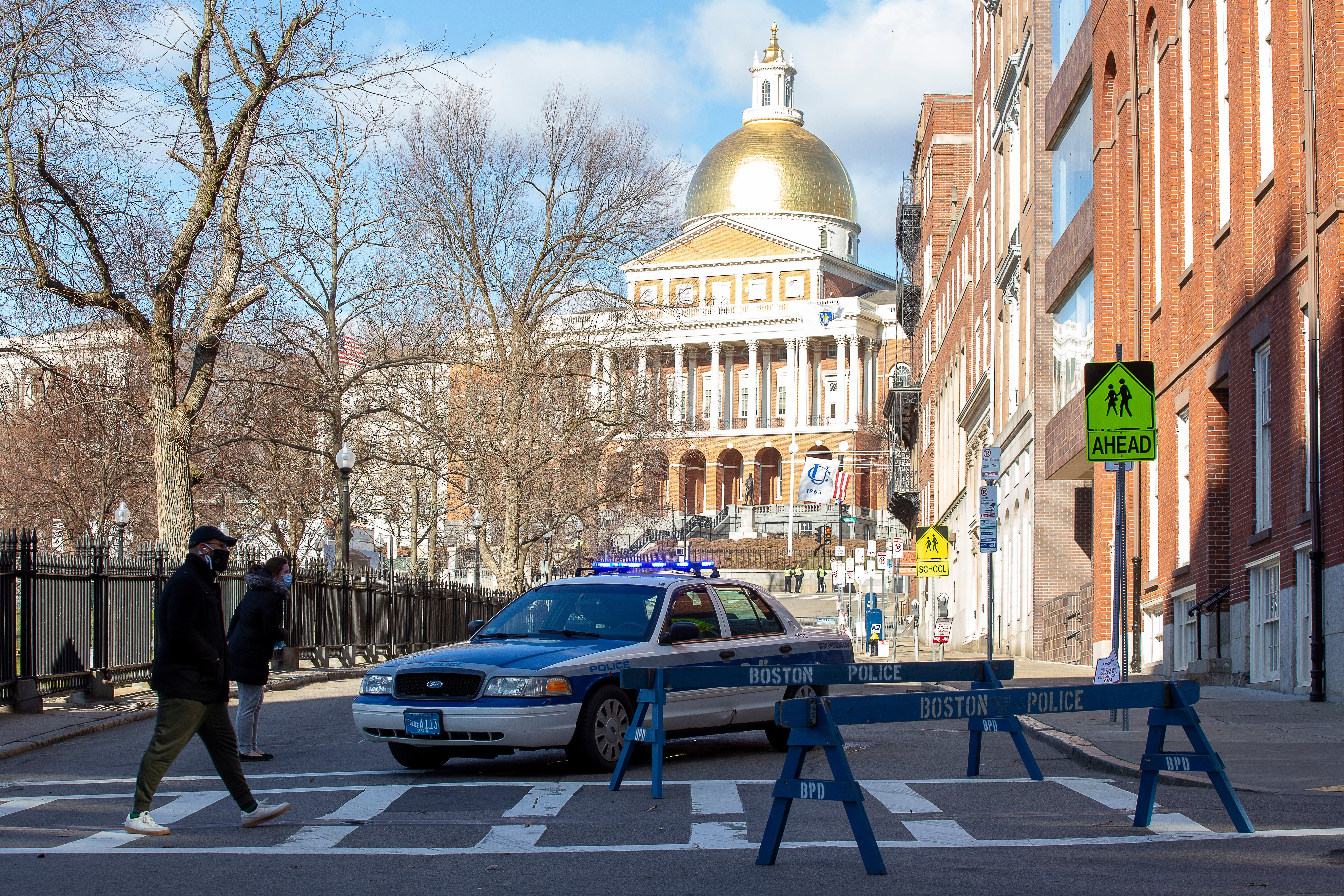 A number of streets in Boston's Beacon Hill around the Statehouse were closed down Sunday, Jan. 17, 2021, as a precaution to any protesters in the wake of the storming of the U.S. Capitol this month and ahead of the presidential inauguration.