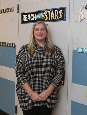 Christy Woodburn, a middle school teacher at St. Anthony of Padua School in Akron, is a Make the Grade Amazing Teacher.