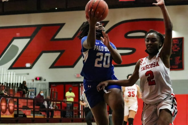 Lashonda Stiger goes up for a lay-up against the Lady Rebels Friday night. (Ben Jenkins/for the Amarillo Globe-News)