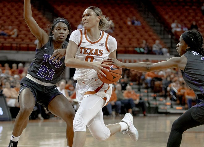 Texas guard Celeste Taylor drives to the hoop against TCU forward Michelle Berry during their game in Austin last season.