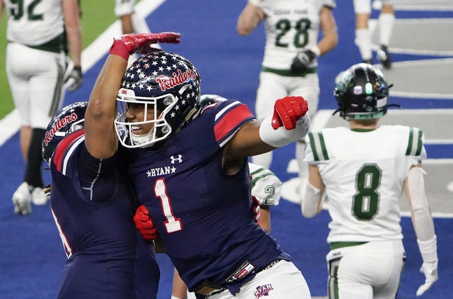 Denton Ryan's Ja'Tavion Sanders celebrates his touchdown catch in the 59-14 win over Cedar Park in the Class 5A Division I state championship game.