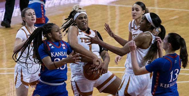 Texas center Lauren Ebo (1) battles Kansas' Chandler Prater (25) for a rebound as UT basketball players Shay Holle (10), Celeste Taylor (0) and Charli Collier (35) look on at the Erwin Center on Jan. 14, 2021.