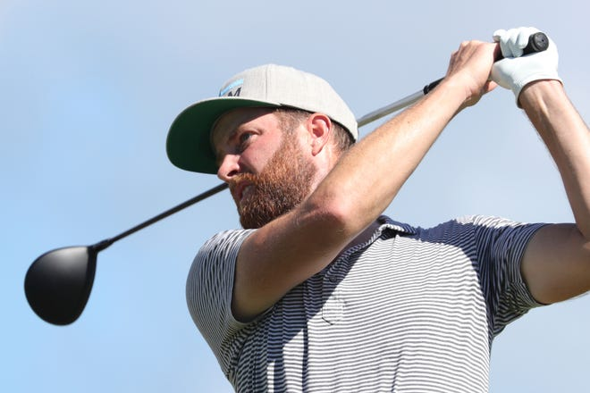 Chris Kirk follows his shot off the first tee during the third round at the Sony Open in Honolulu.