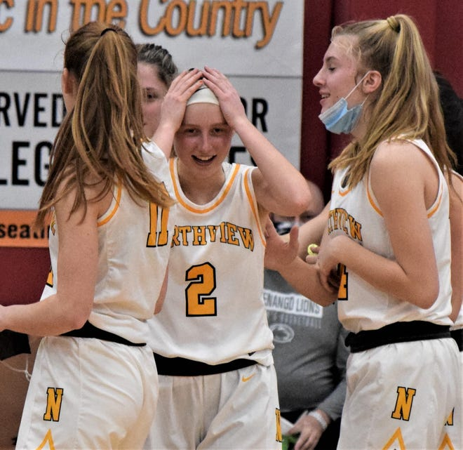 Northview's Taylor Stacy (2) reacts after hitting the game-winning shot against Magnificat.