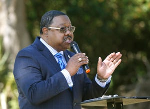 """The Rev. L. Ronald Durham speaks during a """"Building Bridges Rather Than Barriers"""" march commemorating Martin Luther King Day in Port Orange on Monday, Jan. 18, 2021. Durham has been elected president of the Volusia County Democratic Black Caucus."""