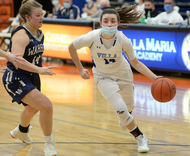 Villa Maria's Ava Waid, right, drives around Warren's Kelsey Stuart in a Region 6 basketball game Jan. 18 at Joann Mullen Gymnasium. Villa remains the No. 1 team in District 10 among the big schools.