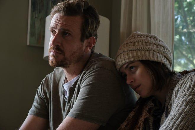 "Jason Siegel and Dakota Johnson in ""Our Friend."""