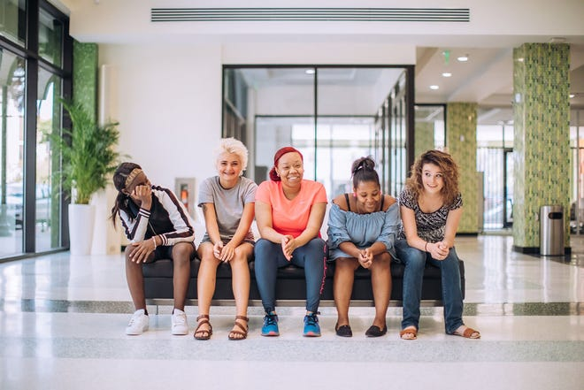 """Girls who take part in the Delores Barr Weaver Center's """"Girl Matters: In the Community"""" program, which provides counseling and comprehensive care management for at-risk girls, gather for a group photo."""