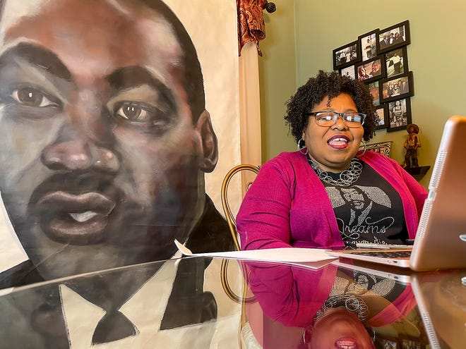 The Rev. Dr. Martin Luther King Jr. Virtual Holiday Celebration was held over Zoom on Monday, Jan. 18, 2021. Committee member Pam Davidson of Galesburg watches and leads on her computer.