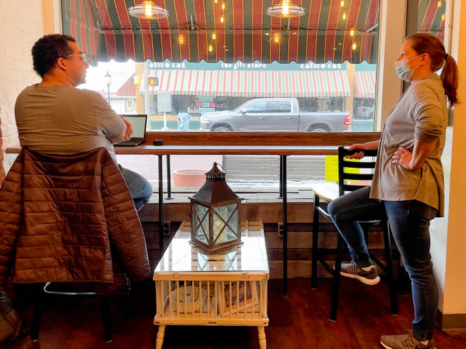 Carriage House Bakery owner Laura Anderson, right, checks in with customer Jeremy Kilgore as he dines inside the restaurant on Monday, Jan. 18, 2021. Illinois' region 2, of which Galesburg is a part of, moved to Tier 1 COVID-19 mitigations this week, which allows for limited indoor dining.