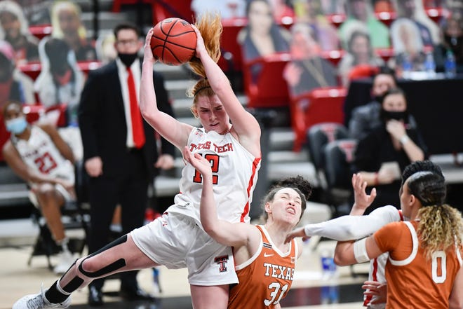 Texas Tech's Vivian Gray (12) gets a rebound during the first half of an NCAA college basketball game against Texas in Lubbock, Texas, Sunday, Jan. 17, 2021. (Justin Rex/For A-J Media)