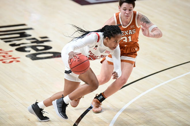 Texas Tech's Alexis Tucker (35) drives to the basket against Texas' Audrey Warren (31) during the first half of a Big 12 Conference women's college basketball game on Jan. 17 at United Supermarkets Arena. (Justin Rex/For A-J Media)
