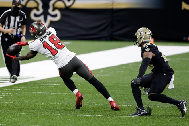 Tampa Bay wide receiver Tyler Johnson made a critical third-and-11 contorting catch for a first down in the fourth quarter Sunday against New Orleans.