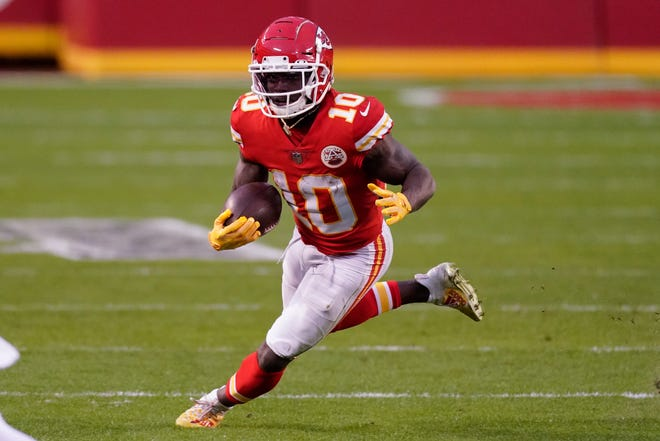 Kansas City Chiefs wide receiver Tyreek Hill runs up field after catching a pass during the second half of an NFL divisional round football game against the Cleveland Browns, Sunday, Jan. 17, 2021, in Kansas City. The Chiefs won 22-17.