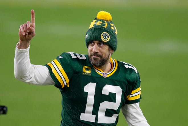 Green Bay Packers quarterback Aaron Rodgers gestures to fans after an NFL divisional playoff football game against the Los Angeles Rams Jan. 16 at Lambeau Field.